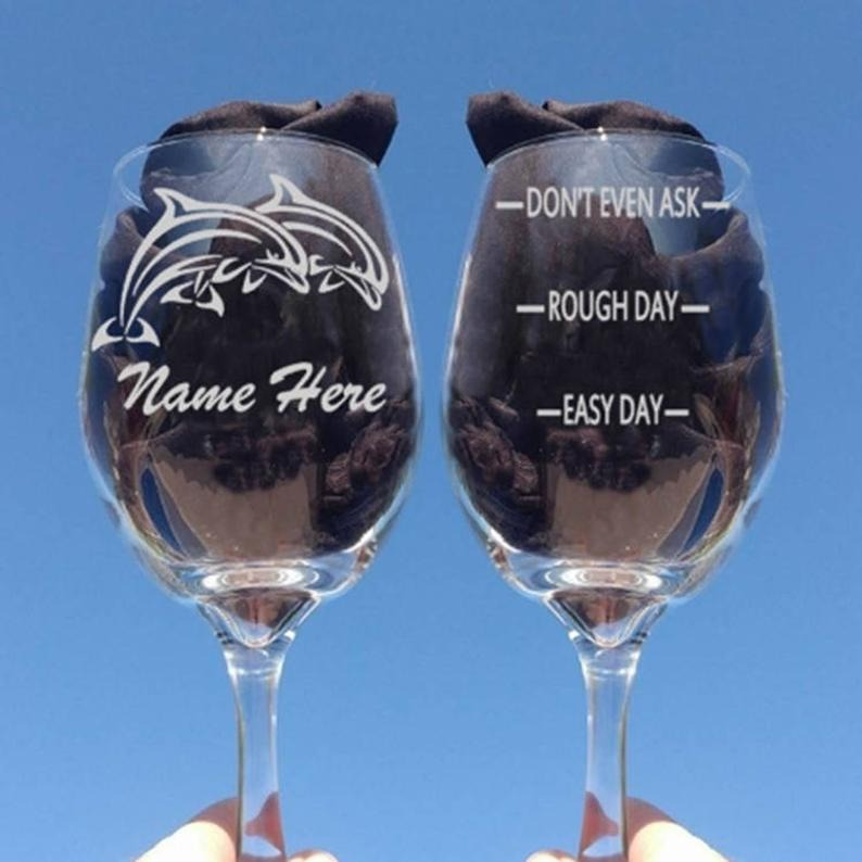 two engraved wine glasses